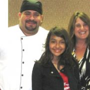 Adrianna posing with a chef and her mother