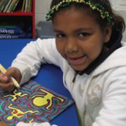 Shyanne drawing a colorful picture with markers