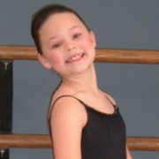 Christina smiling in her ballerina outfit
